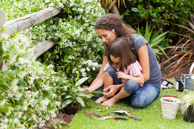 mother-and-daughter-working-in-garden_shutterstock_71162299