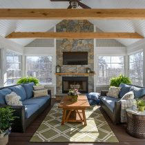 Placement-of-indoor-plants-brings-a-sense-of-symmetry-to-this-cool-modern-sunroom
